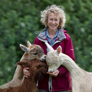 Image of Vicki with huacaya and suri alpacas in Spring Farm.