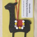 Handmade black alpaca hanging decoration