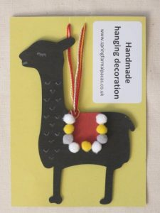 Handmade black alpaca hanging decoration