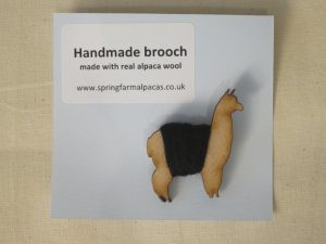 Handmade black wooden alpaca brooch
